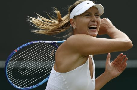 ADVANCE FOR WEEKEND EDITIONS, AUG. 29-30  – FILE – In this July 3, 2015, file photo, Maria Sharapova returns a ball to Irina-Camelia Begu during their singles match at the All England Lawn Tennis Championships in Wimbledon, London. Sharapova is seeded third for the U.S. Open tennis tournament. (AP Photo/Pavel Golovkin, File)